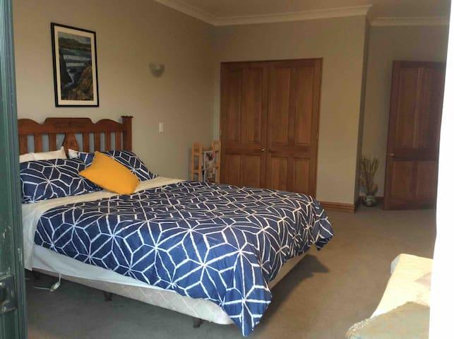Bedroom #1 Queen bed and wardrobe