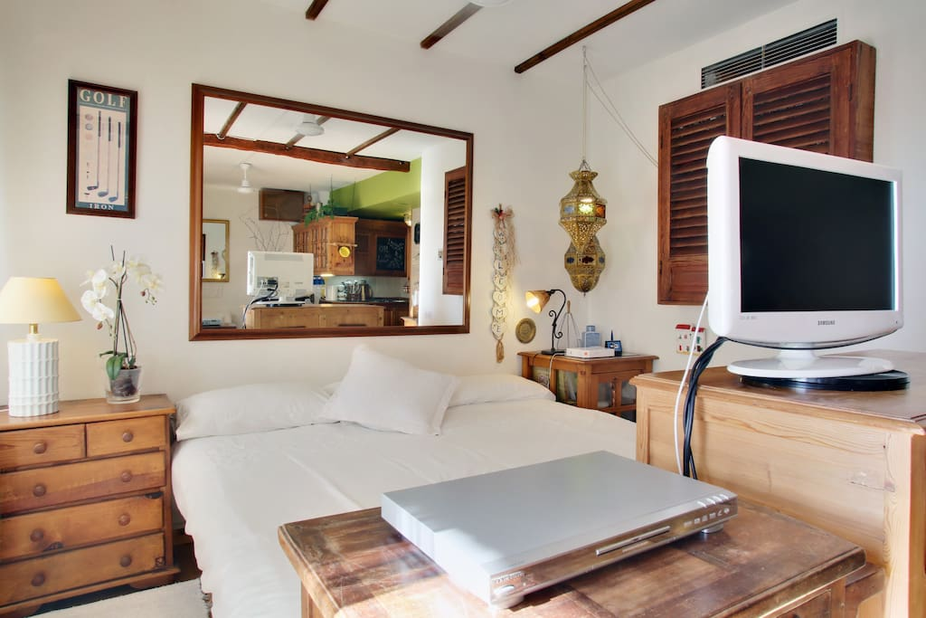A comfortable double bed with television to watch