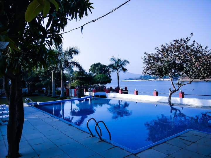 Lake and Pool facing Cottage For 2 People Udaipur