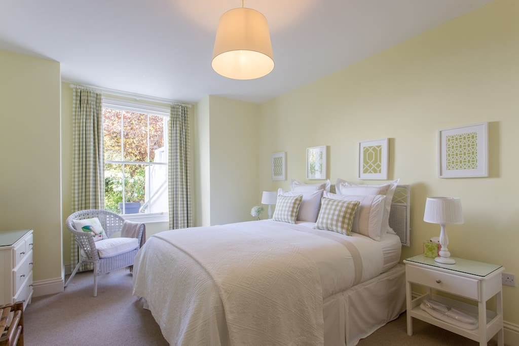Bedroom with king size bed and view to front garden