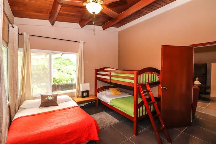 Main House - Guest Bedroom #1  1 Queen Bed  1 Bunkbed