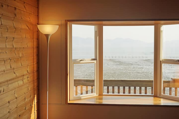 Cozy wooden room with attic A,  by seaside,mudflat