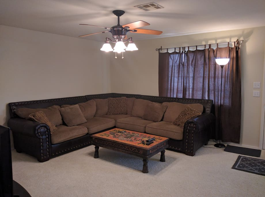 Comfortable and large sofa can be used as a bed for a 5th guest.