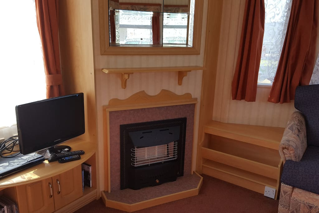 TV with DVD player, gas fire