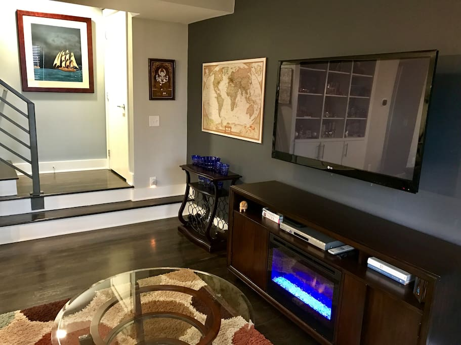 """Living Room w/ Fireplace and 55"""" TV"""
