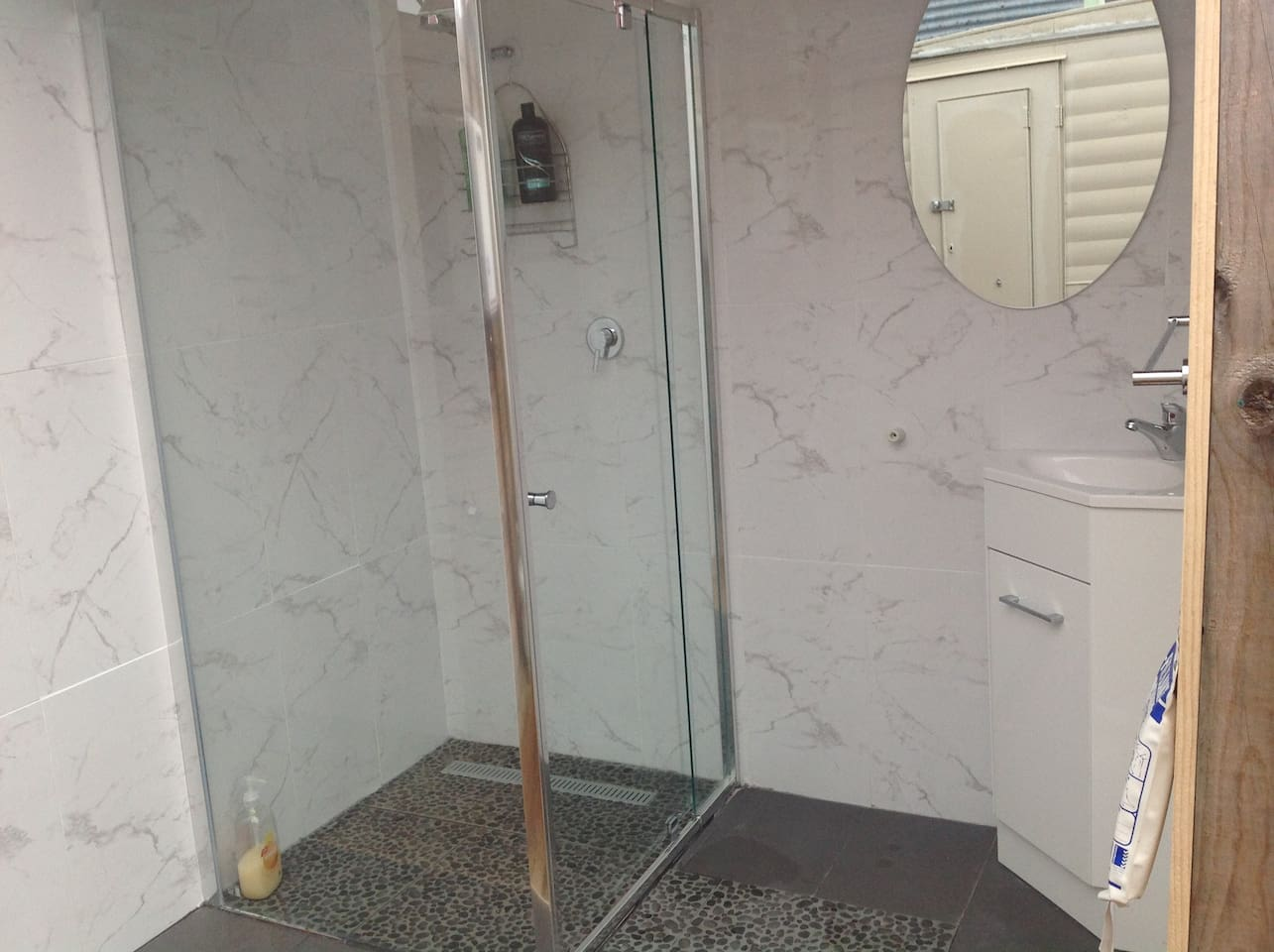 Enclosed outside shower on the caravan deck, plenty of hot water.