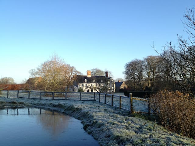 Winter view of the Hall from duck pond