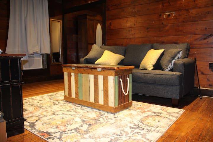 extra towels, sheets, blanket inside trunk coffee table