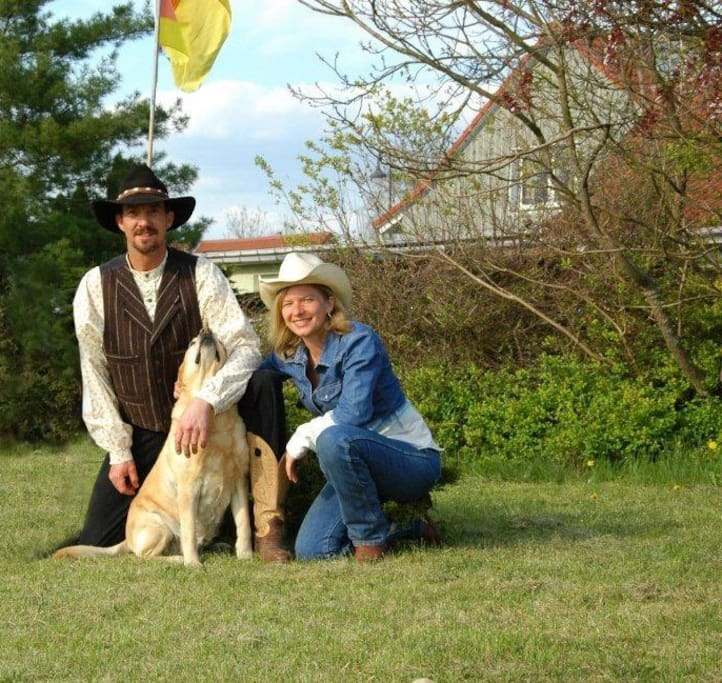 Ranch Manager, Keith Lanegan and Sunshine Ranch Owner, Sonja Lange  with their favorite dog Emily.