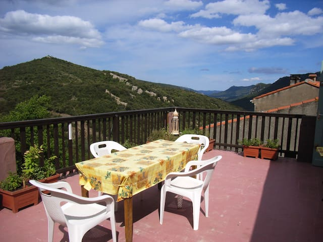The terrace is large and has a BBQ. It has  several reclining chairs to relax in as well as 8 white chairs.