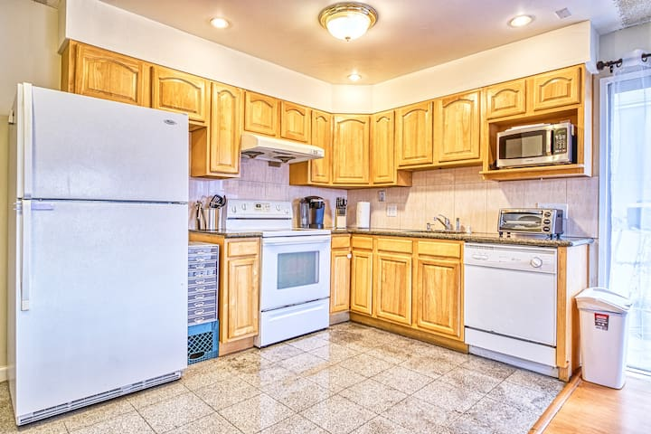 The kitchen is open to the living and dining areas. It has a full stove, oven, dishwasher and plenty of cabinet space--everything you need to prepare a gourmet meal!
