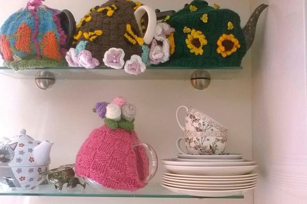 Some of my teapots. I like to bake cakes and make afternoon tea.