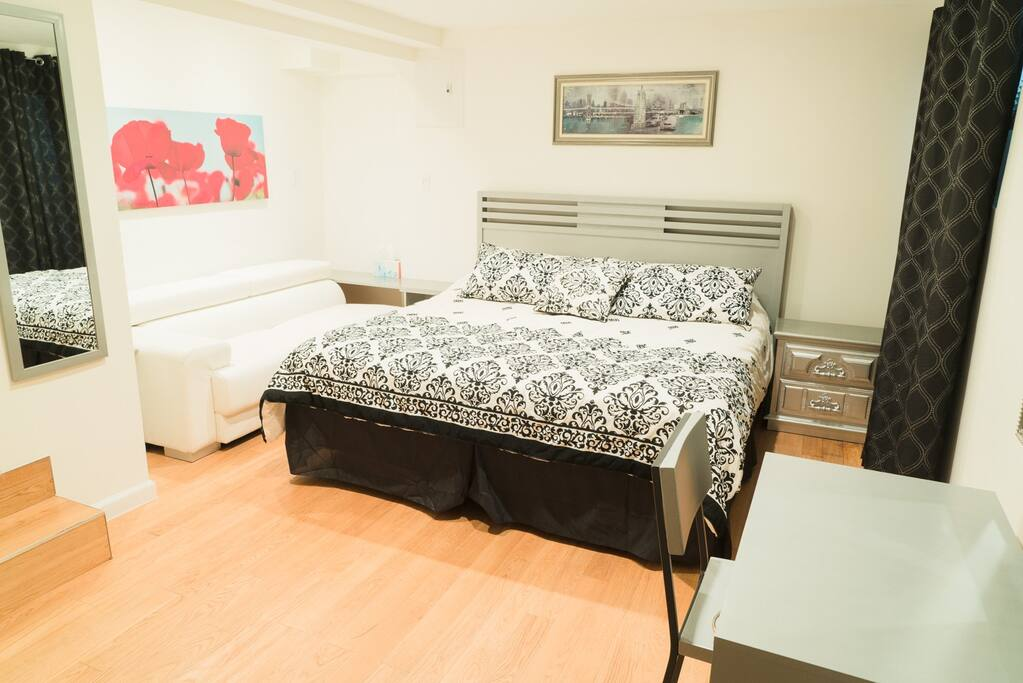 Master bedroom en-suite with King Size bed, couch and Smart TV for your enjoyment.