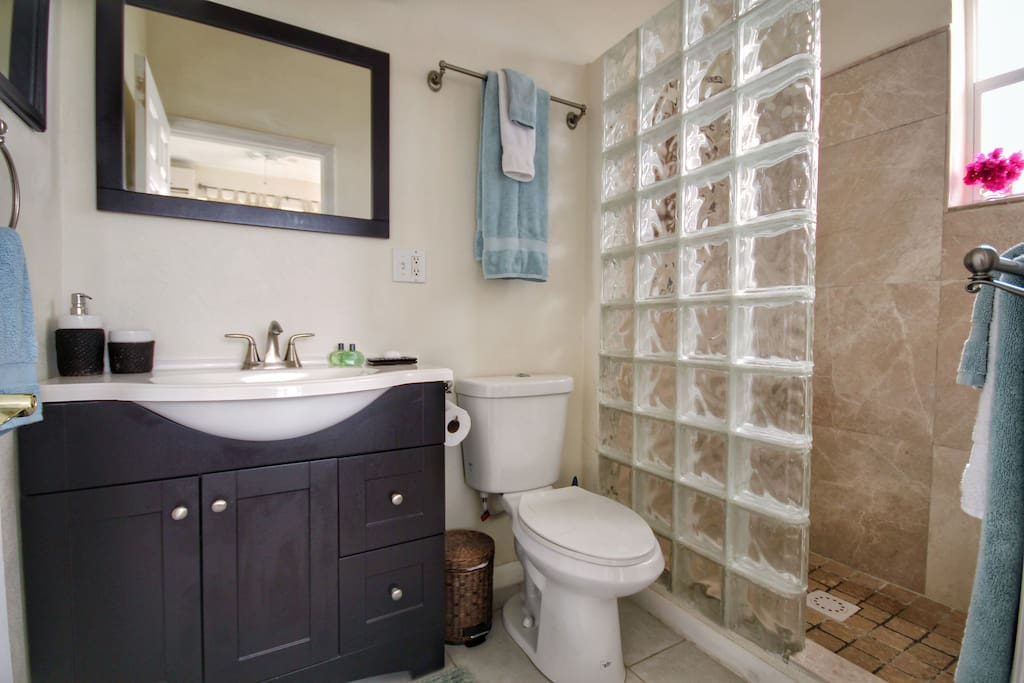 Spacious and modern en suite with walk-in shower