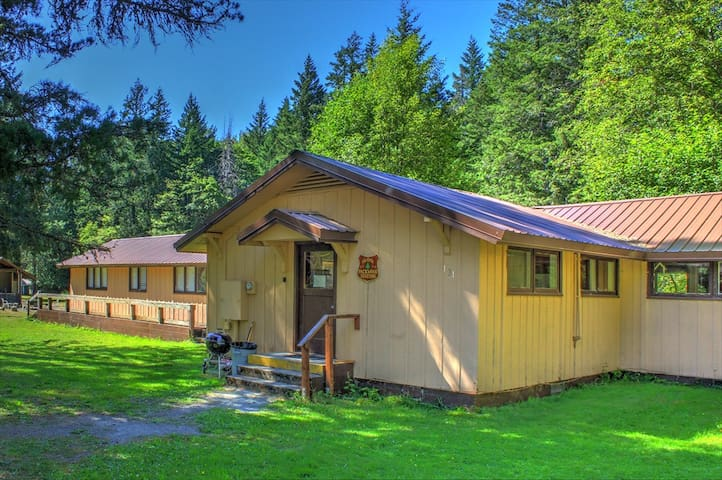 The bunkhouse is located in a wooded setting with plenty of parking out front, several grills, a fire pit and horseshoes.