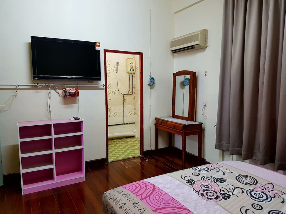 Master bedroom with ensuite toilet (cold shower), dressing table and air conditioner.  Hot shower is available in shared bathroom right outside the room.