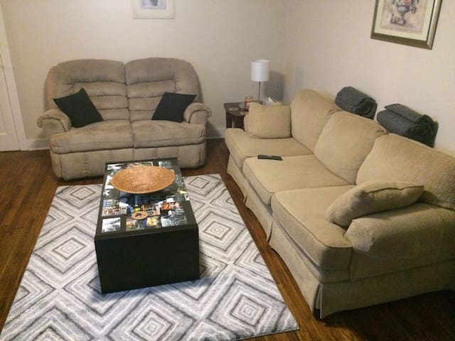 The love seat reclines and the couch pulls out into a bed. The little lamp has a USB port, too!