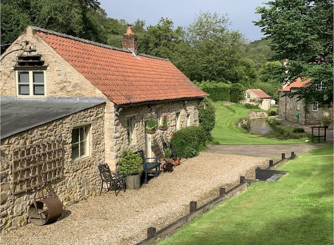 Mill Cottage with waterfall in North Yorkshire