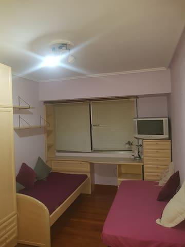 Habitacion grande dos camas
