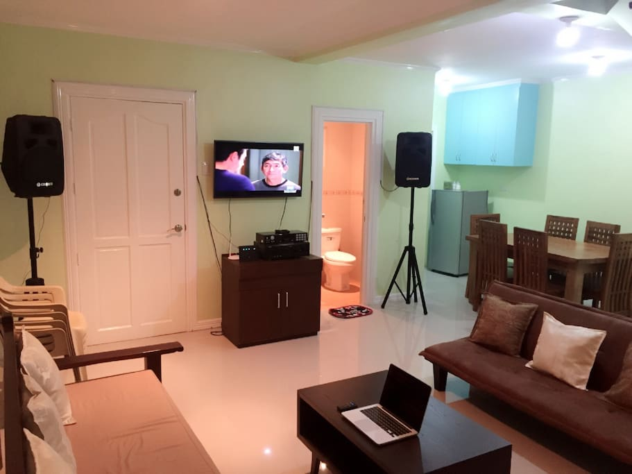 Wide air-conditioned living room with commercial grade entertainment system.