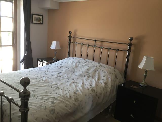 Stylishly furnished bedroom.