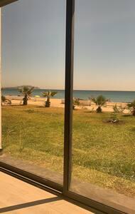Maison de luxe, pied dans l'eau à Mdiq