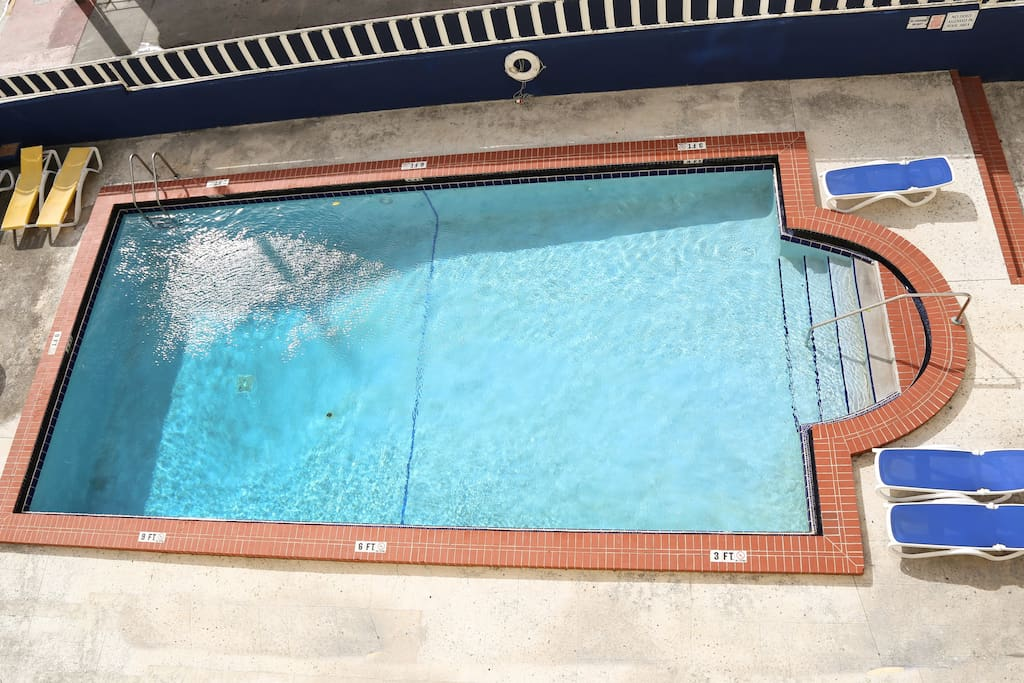 Large pool - 3 ft to 9 ft deep.  Pool is approx. 6 ft above street level