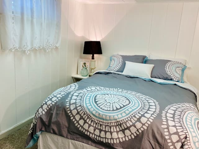 """The side bedroom has a queen bed, as well as a 32"""" TV with Amazon Firestick and live TV on YouTube TV."""