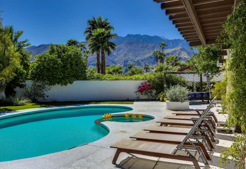 The only tough choice - enjoy the mountain views from a hot tub, or from a lounger?