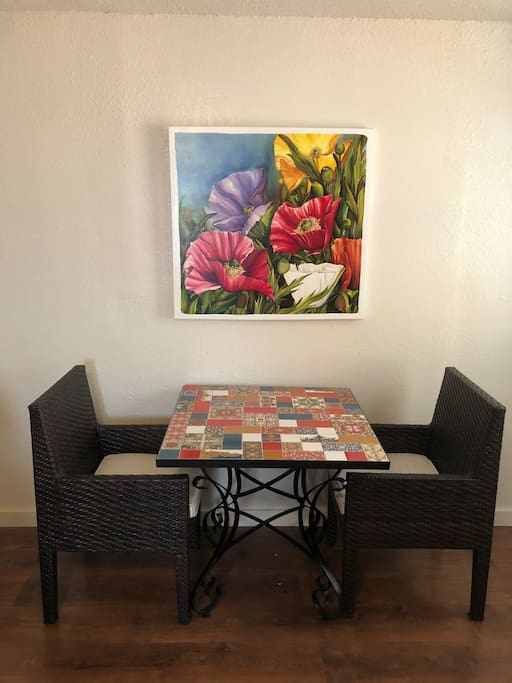 Dining Area with chairs, check out the original artwork above by a local artist! Wow!