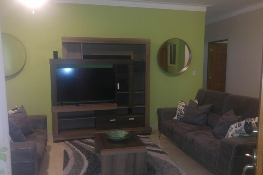 "Living Room area with 55"" TV, soundbar a d satellites"