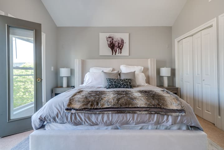 Alpharetta bedroom features King-sized bed with third floor deck access adjoining room