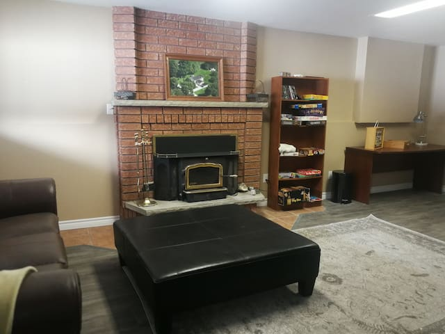 Living Dining Area has a working fireplace, couch and ottoman area.