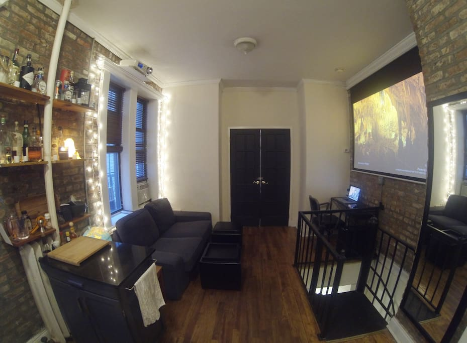 Upstairs living room with bar and movie theater.