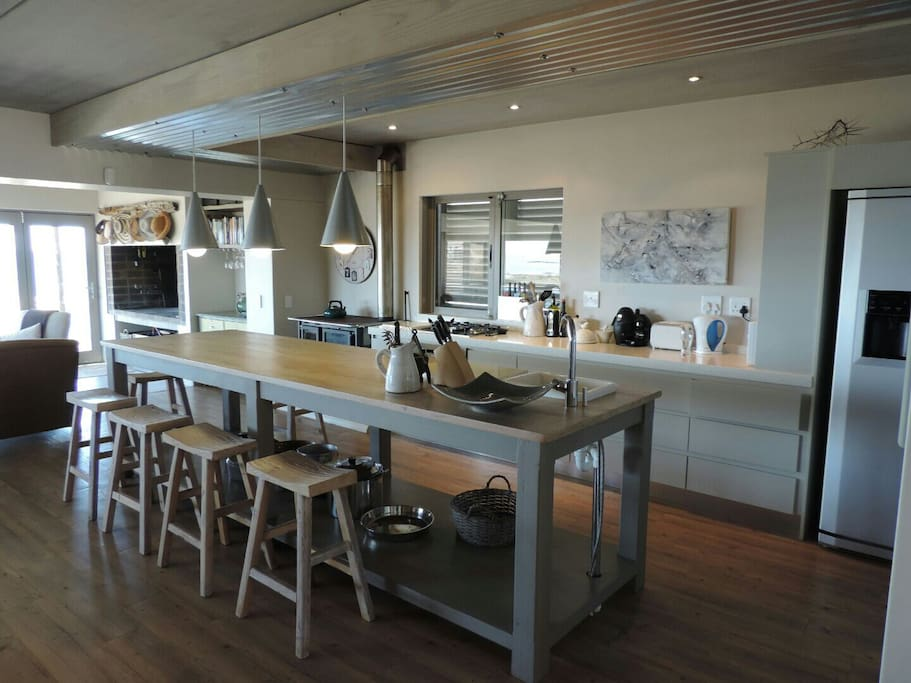 Kitchen area. Wonderful preparation and dining table.