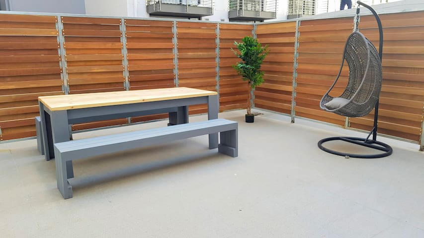 Large private courtyard with modern  seating provided