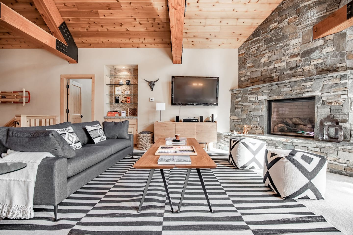 Exposed wooden beams bring a touch of cozy to the space.