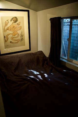 ENTRANCE TO THE UNCONVENTIAL BEDROOM - FULL BED WITH LARGE WINDOW -- FEELS LIKE A LITTLE CACOON = COMFY LITTLE SANCTUARY