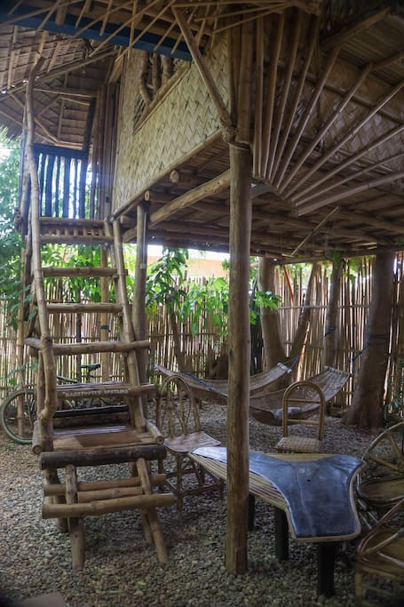 Downstairs with hammocks and table set