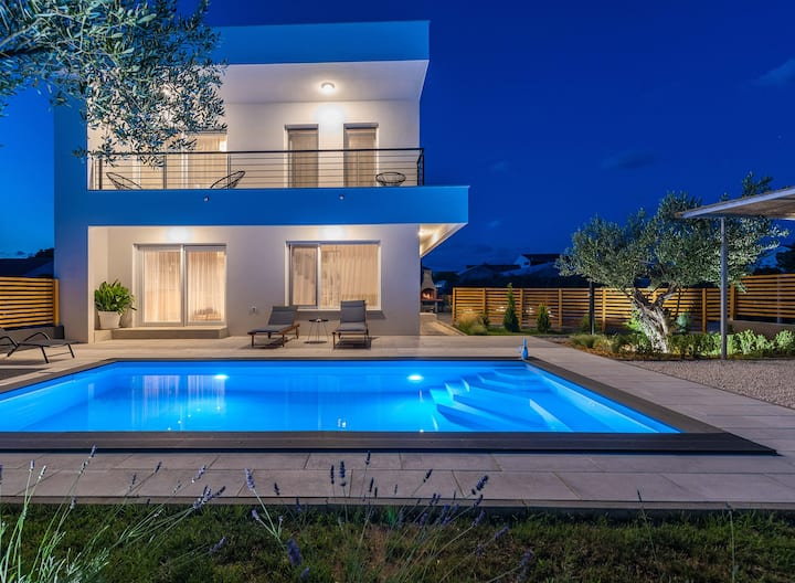 Modern house with private yard and heated pool.