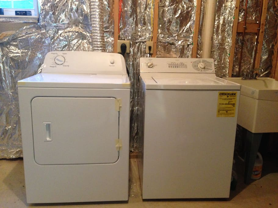 Washer, dryer and sink in the basement utility room.