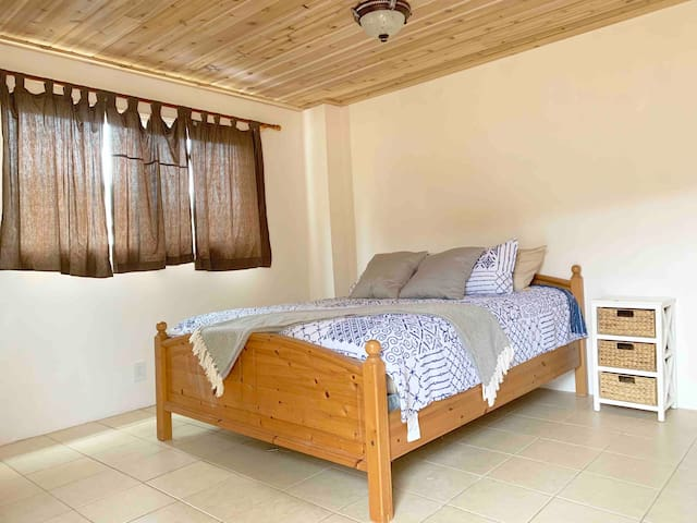 Private Master bedroom + bathroom suite with AC