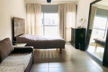 Living room with double bed and sofa