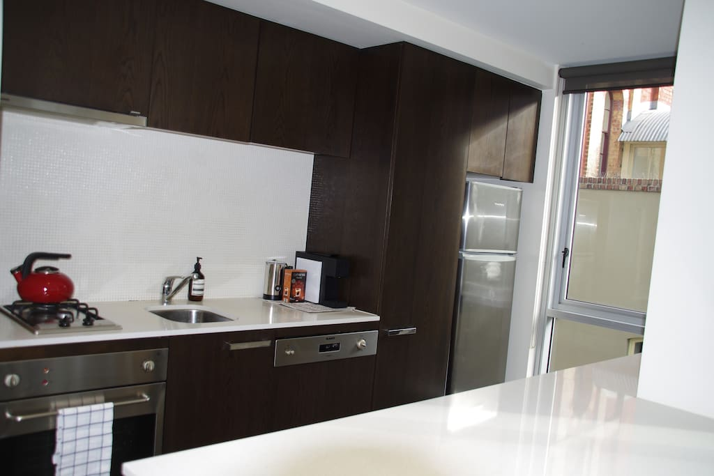 Breakfast bar and complete kitchen