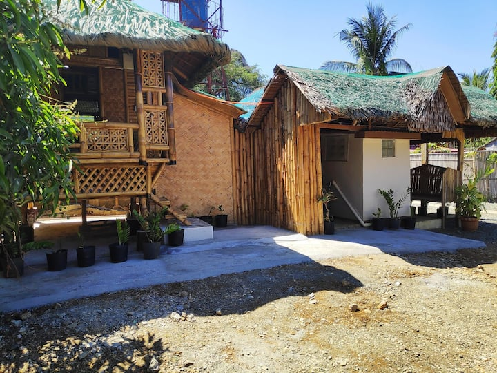2 room 4 beds nipa hut with AC & 2 private CR