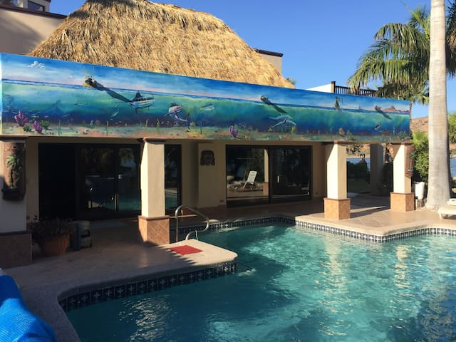The Palapa Grandé, Casitas and outdoor living areas all center around the large heated pool and hot tub. Outdoor painted mural by, local artist Oscar Zapeta, feature the big game fish of the Sea of Cortez.