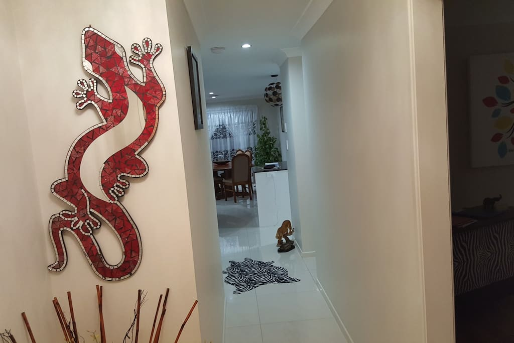 Main entrance with a good luck goanna lizard and a touch of African