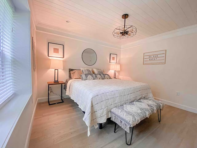 Master Bedroom equipped with one king power bed, walk in closet and smart tv. Please note that mattress is firm.