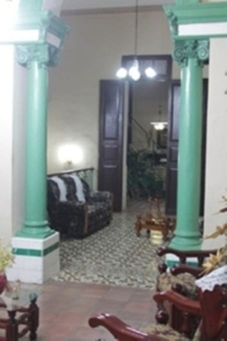 """Santa Clara Bed and Breakfast Guest Cuba Vista Park Hostal Vista Park: the most centrally located hostel colonial Santa Clara, Cuba.  The house has a wonderful eclectic architecture and colonial floors with a height from floor to ceiling of 6 meters, is similar to a small castle composed of six rooms of 25 square meters and a unique view compared to any other hostel in the city. Colonial home in the heart of Santa Clara, with a classic, spacious and airy colonial ambience, in very good condition and comfort, to the right of the provincial library """"José Martí"""", and overlooking the Parque Vidal, nearly all centers cultural, where you have access to the extensive cultural life of the city. The house has a large terrace where you can see the whole panorama of the city and the oldest city clock. All sights of the city are within reach of our house, banks and ATMs to withdraw cash, decorative arts museums, theater, cinema, night places available for parties, all agencies travel and tour desk are just 100 meters from our house, the mausoleum of Che is 2 kilometers from our house, the armored train 600 meters. The house has 3 large rooms for rent, 6 square meters each. Two rooms with three beds, a double and two staff, and other bedroom has two twin beds that can be 4 people for a total of 12 people in 3 bedrooms, is more expensive than other houses as the rooms are very spacious and can choose instead of two rooms can select, whether friends or family, also has the privilege that is in the area of wireless Internet access and can access it from the balconies or rooms, because it is located in the Vidal park area, rooms also have air conditioners, refrigerators, televisions, fans and natural ventilation, balconies overlooking the park Vidal, one of the rooms is located on the terrace where you can observe the whole city. Each room has a private bathroom with hot and cold water. Plus 2 rooms with balconies, where you can observe the daily life of the city, you can also sunba"""