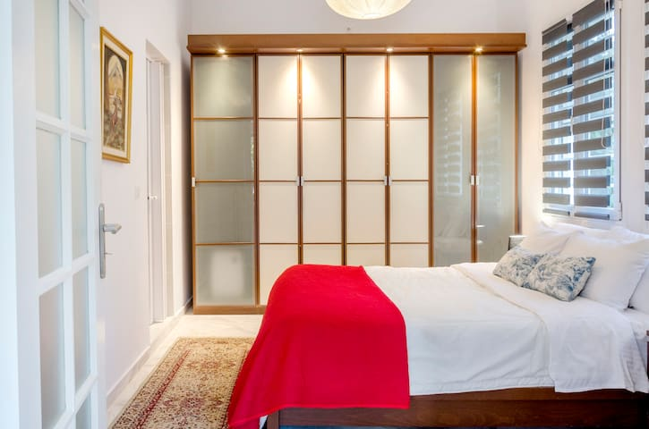 Bedroom with a queen-size bed and a built-in wardrobe